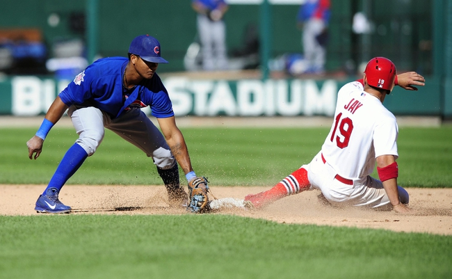 Sep 29, 2013; St. Louis, MO, USA; St. Louis Cardinals center fielder Jon Jay (19) slides safely past the tag of Chicago Cubs shortstop Starlin Castro (13) during the eighth inning at Busch Stadium. St. Louis defeated Chicago 4-0 and clinched the best record in the National League. Mandatory Credit: Jeff Curry-USA TODAY Sports