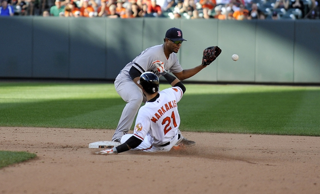 Sep 29, 2013; Baltimore, MD, USA; Baltimore Orioles right fielder Nick Markakis (21) slides into second base safely after hitting a double as Boston Red Sox shortstop Xander Bogaerts (72) in the eighth inning at Oriole Park at Camden Yards. The Orioles won 7-6. Mandatory Credit: Joy R. Absalon-USA TODAY Sports