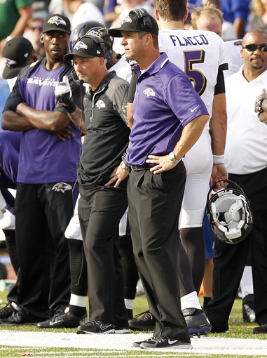 Sep 29, 2013; Orchard Park, NY, USA; Baltimore Ravens head coach John Harbaugh (right) watches the game against the Buffalo Bills during the second half at Ralph Wilson Stadium. The Bills won 23-20. Mandatory Credit: Kevin Hoffman-USA TODAY Sports