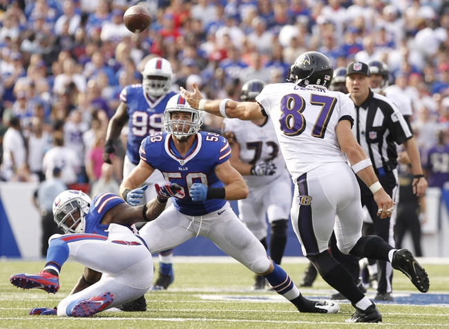 Sep 29, 2013; Orchard Park, NY, USA; Buffalo Bills middle linebacker Kiko Alonso (50) intercepted a pass as Baltimore Ravens tight end Dallas Clark (87) during the second half at Ralph Wilson Stadium. The Bills won 23-20. Mandatory Credit: Kevin Hoffman-USA TODAY Sports