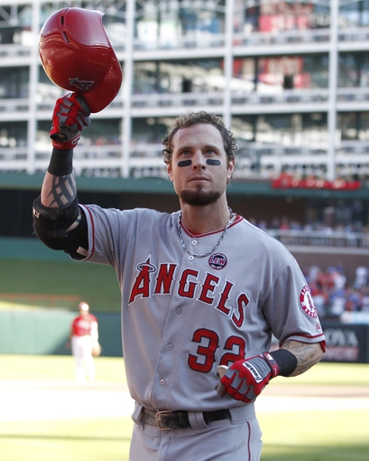 Sep 29, 2013; Arlington, TX, USA; Los Angeles Angels left fielder Josh Hamilton (32) acknowledges the fans after his last at bat against the Texas Rangers at Rangers Ballpark in Arlington. The Rangers beat the Angels 6-2. Mandatory Credit: Tim Heitman-USA TODAY Sports