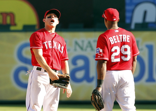Sep 29, 2013; Arlington, TX, USA; Texas Rangers second baseman Ian Kinsler (5) celebrates with third baseman Adrian Beltre (29) after the game against the Los Angeles Angels at Rangers Ballpark in Arlington. The Rangers beat the Angels 6-2. Mandatory Credit: Tim Heitman-USA TODAY Sports