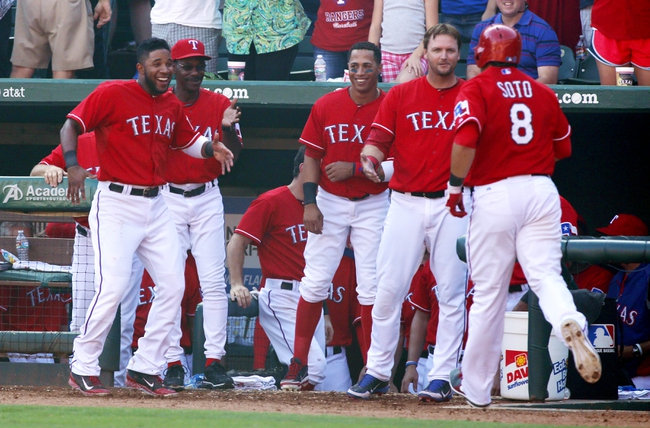 Sep 29, 2013; Arlington, TX, USA; Texas Rangers shortstop Elvis Andrus (1) manager Ron Washington (38) center fielder Leonys Martin (2) and designated hitter A.J. Pierzynski (12) congratulate Texas Rangers catcher Geovany Soto (8) after he hit a home run in the eighth inning of the game against the Los Angeles Angels at Rangers Ballpark in Arlington. The Rangers beat the Angels 6-2. Mandatory Credit: Tim Heitman-USA TODAY Sports