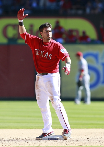 Sep 29, 2013; Arlington, TX, USA; Texas Rangers catcher Geovany Soto (8) waves to the dugout after hitting a two run double in the sixth inning of the game against the Los Angeles Angels at Rangers Ballpark in Arlington. The Rangers beat the Angels 6-2. Mandatory Credit: Tim Heitman-USA TODAY Sports