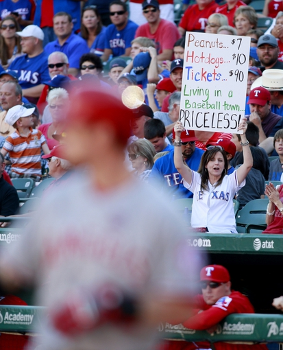 Sep 29, 2013; Arlington, TX, USA; A Texas Rangers fans holds up a sign during Los Angeles Angels left fielder Josh Hamilton (32) at bat in the ninth inning of the game at Rangers Ballpark in Arlington.The Rangers beat the Angels 6-2.  Mandatory Credit: Tim Heitman-USA TODAY Sports