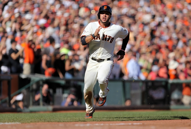 Sep 29, 2013; San Francisco, CA, USA; San Francisco Giants center fielder Gregor Blanco (7) scores the second run on a two run RBI single by right fielder Hunter Pence (not pictured) against the San Diego Padres during the seventh inning at AT&T Park. Mandatory Credit: Kelley L Cox-USA TODAY Sports