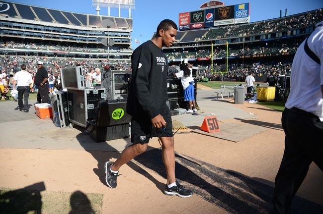 Sep 29, 2013; Oakland, CA, USA; Oakland Raiders quarterback Terrelle Pryor (2) walks off the field after the game against the Washington Redskins at O.co Coliseum. The Redskins defeated the Raiders 24-14. Mandatory Credit: Kyle Terada-USA TODAY Sports