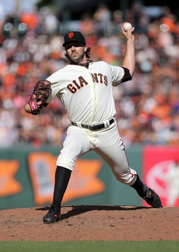 Sep 29, 2013; San Francisco, CA, USA; San Francisco Giants pitcher Barry Zito (75) pitches the ball against the San Diego Padres during the eighth inning at AT&T Park. Mandatory Credit: Kelley L Cox-USA TODAY Sports