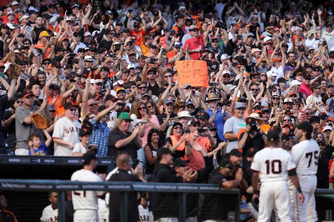 Sep 29, 2013; San Francisco, CA, USA; San Francisco Giants fans cheer for San Francisco Giants pitcher Barry Zito (75) as he leaves the field during the eighth inning against the San Diego Padres at AT&T Park. Mandatory Credit: Kelley L Cox-USA TODAY Sports