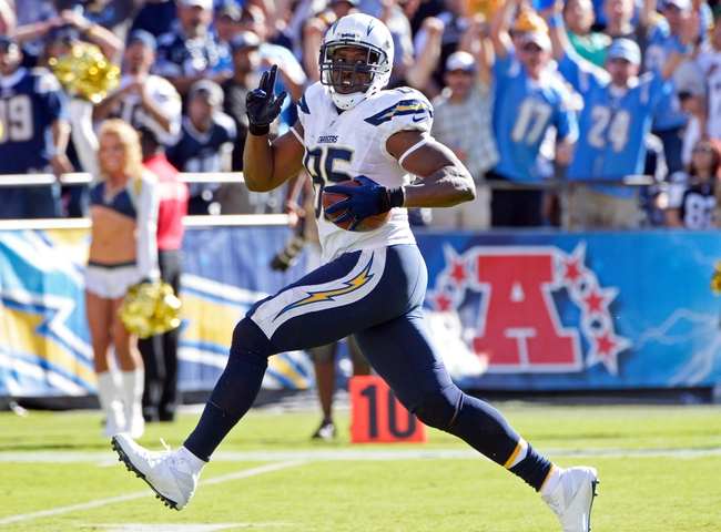 Sep 29, 2013; San Diego, CA, USA; San Diego Chargers tight end Antonio Gates (85) scores a touchdown on a 56-yard pass play from quarterback Philip Rivers (not pictured) during second half action against the Dallas Cowboys at Qualcomm Stadium.  Mandatory Credit: Robert Hanashiro-USA TODAY Sports