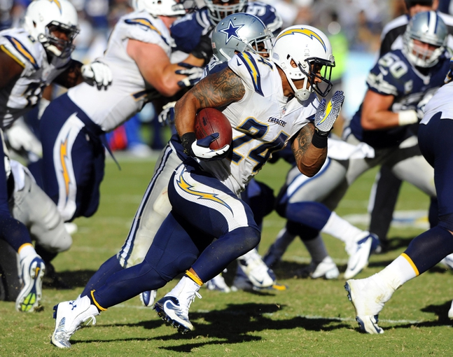 Sep 29, 2013; San Diego, CA, USA; San Diego Chargers running back Ryan Mathews (24) runs for a short gain during the second half against the Dallas Cowboys at Qualcomm Stadium. Mandatory Credit: Christopher Hanewinckel-USA TODAY Sports