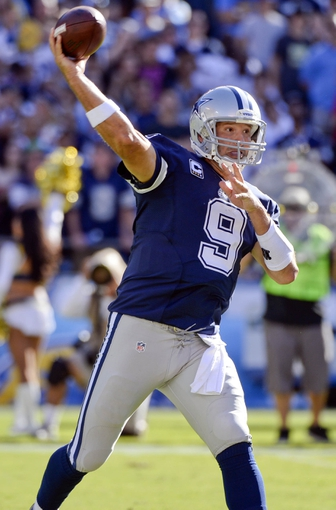 Sep 29, 2013; San Diego, CA, USA; Dallas Cowboys quarterback Tony Romo (9) throws a pass in the fourth quarter against the San Diego Chargers at Qualcomm Stadium. Romo was 27 of 37 passing for 244 yards and two touchdowns. Mandatory Credit: Robert Hanashiro-USA TODAY Sports
