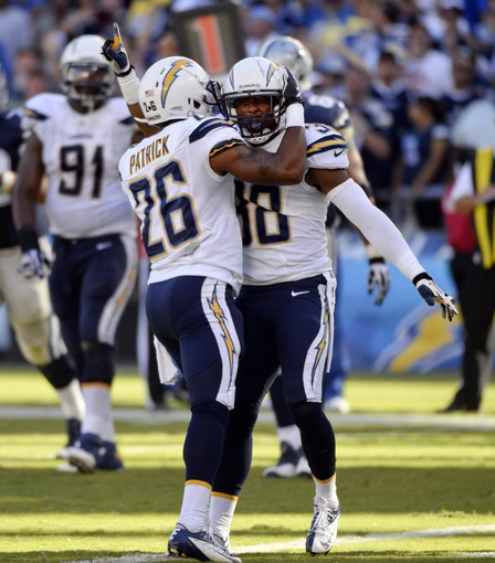 Sep 29, 2013; San Diego, CA, USA; San Diego Chargers cornerback Johnny Patrick (26) and San Diego Chargers strong safety Marcus Gilchrist (38) celebrate stopping a fourth quarter Dallas Cowboy drive at Qualcomm Stadium. Mandatory Credit: Robert Hanashiro-USA TODAY Sports