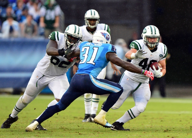 Sep 29, 2013; Nashville, TN, USA; New York Jets running back Tommy Bohanon (40) carries the ball against Tennessee Titans safety Bernard Pollard (31) during the second half at LP Field. The Titans beat the Jets 38-13. Mandatory Credit: Don McPeak-USA TODAY Sports
