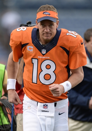 Sep 29, 2013; Denver, CO, USA; Denver Broncos quarterback Peyton Manning (18) runs off the field after defeating thePhiladelphia Eagles 52-20 at Sports Authority Field at Mile High. Mandatory Credit: Ron Chenoy-USA TODAY Sports