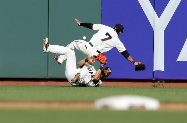 Sep 29, 2013; San Francisco, CA, USA; San Francisco Giants center fielder Angel Pagan (16) and left fielder Gregor Blanco (7) collide as they are unable to catch the ball against the San Diego Padres during the ninth inning at AT&T Park. The San Francisco Giants defeated the San Diego Padres 7-6 with a walk-off win. Mandatory Credit: Kelley L Cox-USA TODAY Sports