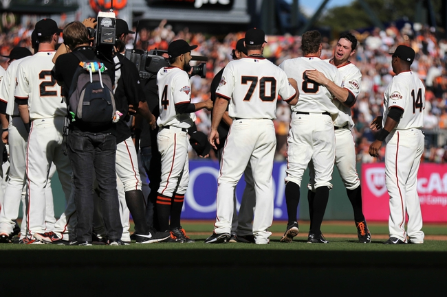 Sep 29, 2013; San Francisco, CA, USA; San Francisco Giants first baseman Brandon Belt (9) hugs right fielder Hunter Pence (8) after Pence hit the RBI single for a walk-off win against the San Diego Padres at AT&T Park. The San Francisco Giants defeated the San Diego Padres 7-6 with a walk-off win. Mandatory Credit: Kelley L Cox-USA TODAY Sports