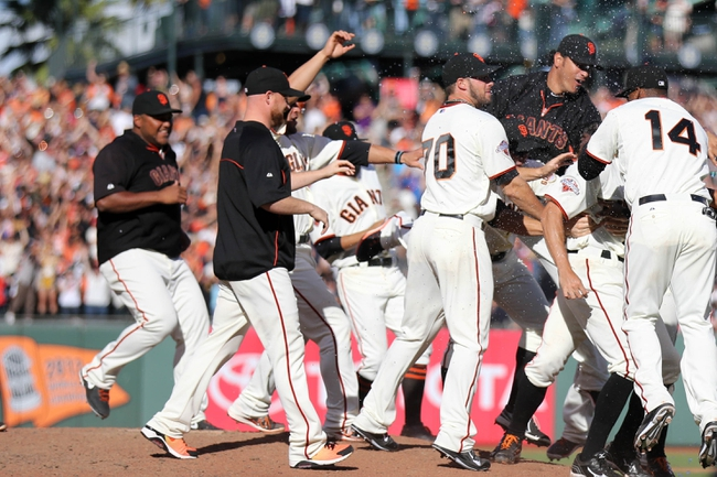 Sep 29, 2013; San Francisco, CA, USA; San Francisco Giants celebrate after the walk off win against the San Diego Padres at AT&T Park. The San Francisco Giants defeated the San Diego Padres 7-6 with a walk-off win. Mandatory Credit: Kelley L Cox-USA TODAY Sports