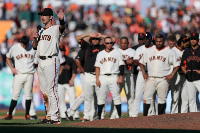 Sep 29, 2013; San Francisco, CA, USA; San Francisco Giants catcher Buster Posey (28) thanks the fans after the final game of the season at AT&T Park. The San Francisco Giants defeated the San Diego Padres 7-6 with a walk-off win. Mandatory Credit: Kelley L Cox-USA TODAY Sports