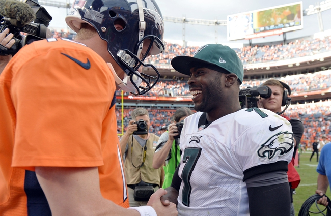 Sep 29, 2013; Denver, CO, USA; Denver Broncos quarterback Peyton Manning (18) and Philadelphia Eagles quarterback Michael Vick (7) greet each other following the game at Sports Authority Field at Mile High. The Broncos defeated the Eagles 52-20. Mandatory Credit: Ron Chenoy-USA TODAY Sports