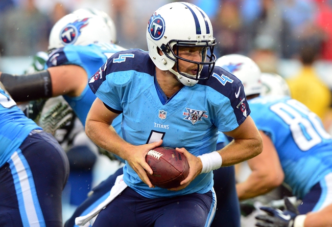 Sep 29, 2013; Nashville, TN, USA; Tennessee Titans quarterback Ryan Fitzpatrick (4) drops back into the pocket against the New York Jets during the second half at LP Field. The Titans beat the Jets 38-13. Mandatory Credit: Don McPeak-USA TODAY Sports