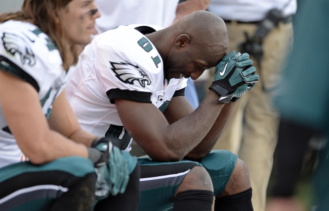 Sep 29, 2013; Denver, CO, USA; Philadelphia Eagles wide receiver Jason Avant (81) reacts on his bench late in the fourth quarter of the game against the Denver Broncos at Sports Authority Field at Mile High. The Broncos defeated the Eagles 52-20. Mandatory Credit: Ron Chenoy-USA TODAY Sports