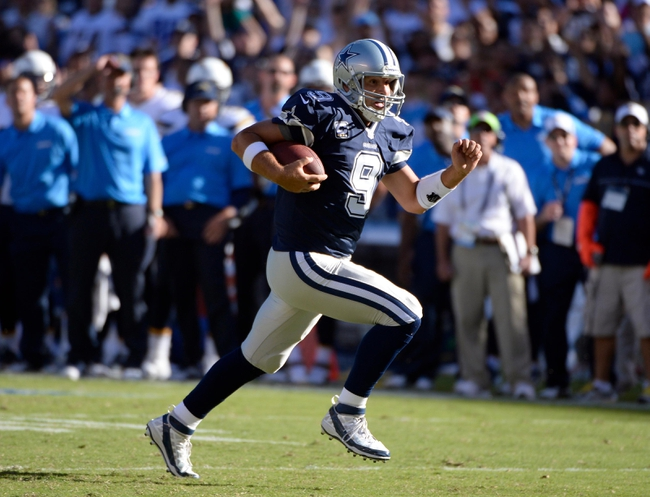 Sep 29, 2013; San Diego, CA, USA; Dallas Cowboys quarterback Tony Romo (9) scrambles for a 15-yard gain during the fourth quarter against the San Diego Chargers at Qualcomm Stadium.  Mandatory Credit: Robert Hanashiro-USA TODAY Sports