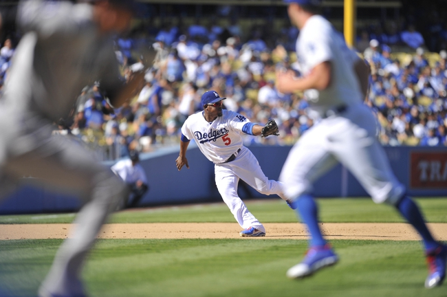 September 29, 2013; Los Angeles, CA, USA; Los Angeles Dodgers  third baseman Juan Uribe (5) fields a hit in the sixth inning against the Colorado Rockies at Dodger Stadium. Mandatory Credit: Gary A. Vasquez-USA TODAY Sports