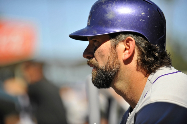 September 29, 2013; Los Angeles, CA, USA; Colorado Rockies first baseman Todd Helton (17) watches game action before coming up to bat in the sixth inning against the Los Angeles Dodgers at Dodger Stadium. Mandatory Credit: Gary A. Vasquez-USA TODAY Sports