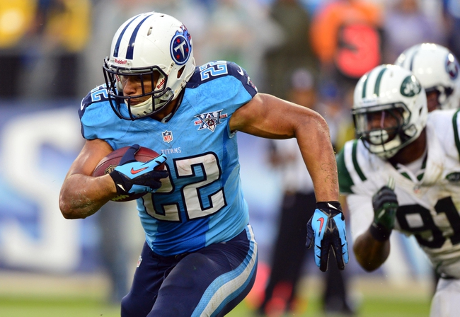 Sep 29, 2013; Nashville, TN, USA; Tennessee Titans running back Jackie Battle (22) runs with the ball against the New York Jets during the second half at LP Field. The Titans beat the Jets 38-13. Mandatory Credit: Don McPeak-USA TODAY Sports