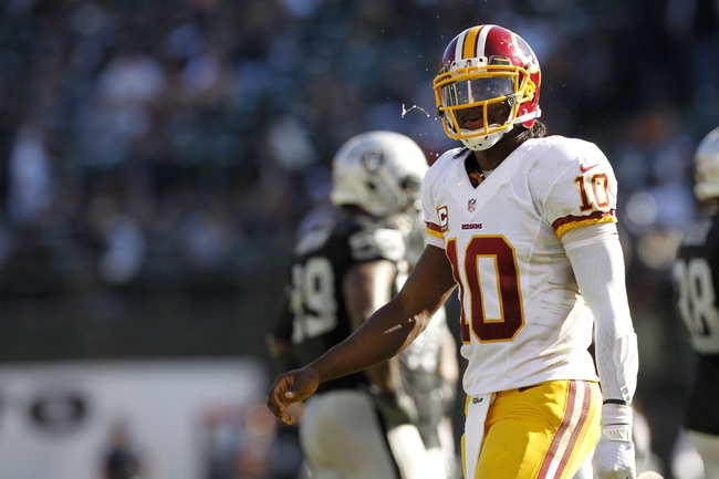 Sep 29, 2013; Oakland, CA, USA; Washington Redskins quarterback Robert Griffin III (10) walks on the field during a break in the action against the Oakland Raiders in the fourth quarter at O.co Coliseum. The Redskins defeated the Raiders 24-14. Mandatory Credit: Cary Edmondson-USA TODAY Sports