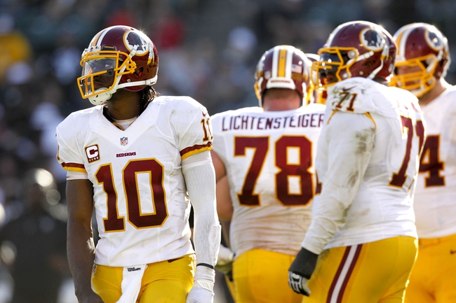 Sep 29, 2013; Oakland, CA, USA; Washington Redskins quarterback Robert Griffin III (10) stands on the field during a break in the action against the Oakland Raiders in the fourth quarter at O.co Coliseum. The Redskins defeated the Raiders 24-14. Mandatory Credit: Cary Edmondson-USA TODAY Sports