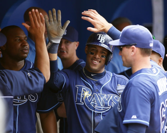Sep 29, 2013; Toronto, Ontario, CAN; Tampa Bay Rays shortstop Yunel Escobar (11) celebrates scoring in the fourth inning against the Toronto Blue Jays at Rogers Centre. Tampa defeated Toronto 7-6. Mandatory Credit: John E. Sokolowski-USA TODAY Sports