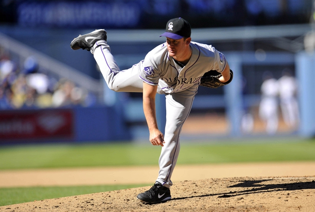 September 29, 2013; Los Angeles, CA, USA; Colorado Rockies starting pitcher Roy Oswalt (44) pitches during the sixth inning against the Los Angeles Dodgers at Dodger Stadium. Mandatory Credit: Gary A. Vasquez-USA TODAY Sports