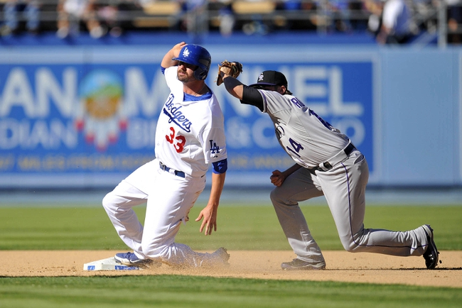 September 29, 2013; Los Angeles, CA, USA; Los Angeles Dodgers left fielder Scott Van Slyke (33) is out at second against the tag of Colorado Rockies second baseman Josh Rutledge (14) in the eighth inning at Dodger Stadium. Mandatory Credit: Gary A. Vasquez-USA TODAY Sports