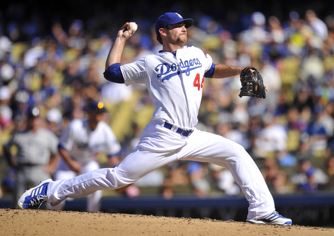 September 29, 2013; Los Angeles, CA, USA; Los Angeles Dodgers relief pitcher Chris Withrow (44) pitches during the seventh inning against the Colorado Rockies at Dodger Stadium. Mandatory Credit: Gary A. Vasquez-USA TODAY Sportsz