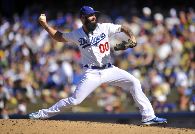 September 29, 2013; Los Angeles, CA, USA; Los Angeles Dodgers relief pitcher Brian Wilson (00) pitches during the eighth inning against the Colorado Rockies at Dodger Stadium. Mandatory Credit: Gary A. Vasquez-USA TODAY Sports