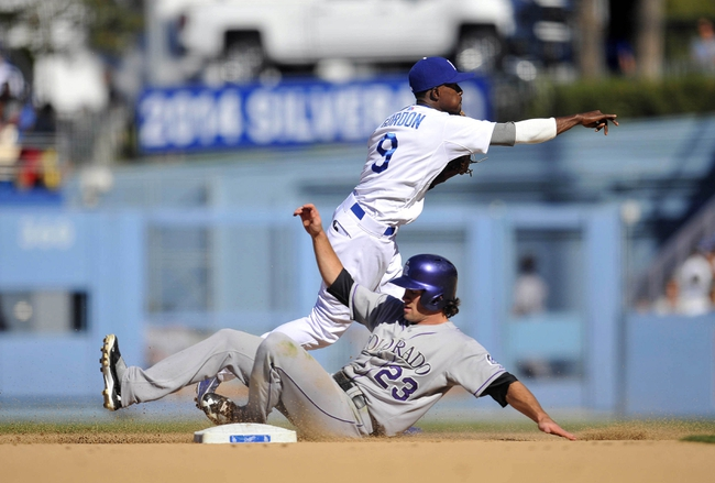 September 29, 2013; Los Angeles, CA, USA; Colorado Rockies second baseman Charlie Culberson (23) is out at second as Los Angeles Dodgers shortstop Dee Gordon (9) throws to first to complete a double play in the eighth inning at Dodger Stadium. Mandatory Credit: Gary A. Vasquez-USA TODAY Sports