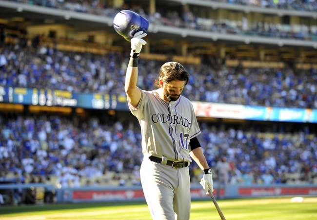 September 29, 2013; Los Angeles, CA, USA; Colorado Rockies first baseman Todd Helton (17) acknowledges the crowd following his final at bat of the game in the ninth inning against the Los Angeles Dodgers at Dodger Stadium. Mandatory Credit: Gary A. Vasquez-USA TODAY Sports