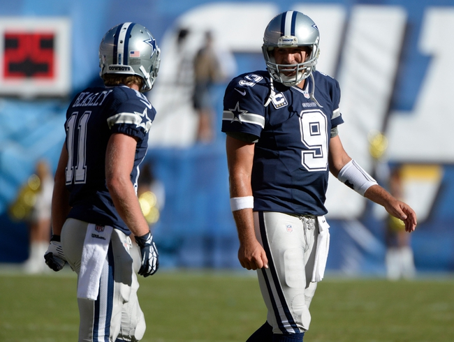 Sep 29, 2013; San Diego, CA, USA; Dallas Cowboys quarterback Tony Romo (9) and wide receiver Cole Beasley (11) during a timeout in the fourth quarter against the San Diego Chargers at Qualcomm Stadium. Mandatory Credit: Robert Hanashiro-USA TODAY Sports