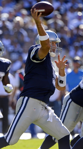 Sep 29, 2013; San Diego, CA, USA; Dallas Cowboys quarterback Tony Romo (9) throws a pass during second half action against the San Diego Chargers at Qualcomm Stadium.  Mandatory Credit: Robert Hanashiro-USA TODAY Sports