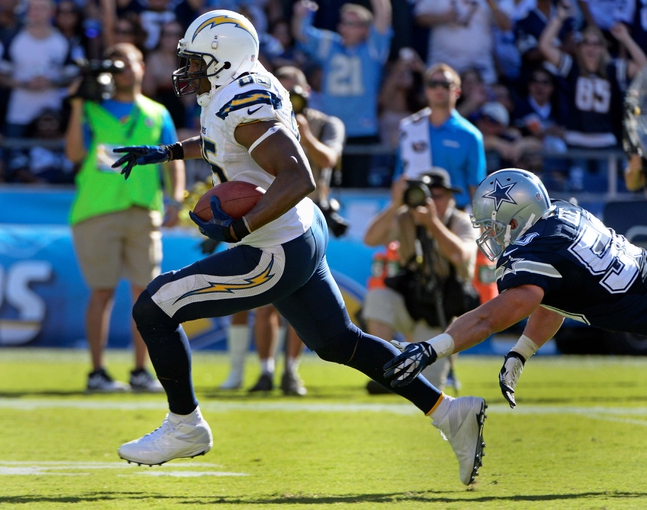Sep 29, 2013; San Diego, CA, USA; San Diego Chargers tight end Antonio Gates (85) gets past Dallas Cowboys middle linebacker Sean Lee (50) on his way to a 56-yard touchdown during the first half at Qualcomm Stadium. Mandatory Credit: Robert Hanashiro-USA TODAY Sports