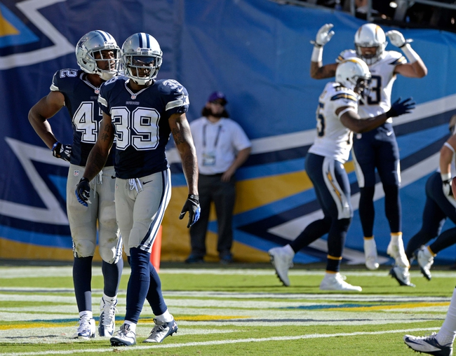 Sep 29, 2013; San Diego, CA, USA; Dallas Cowboys free safety Barry Church (42) and cornerback Brandon Carr (39)