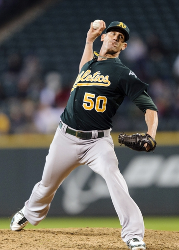 Sep 29, 2013; Seattle, WA, USA; Oakland Athletics relief pitcher Grant Balfour (50) pitches to the Seattle Mariners during the 9th inning at Safeco Field. Oakland defeated Seattle 9-0. Mandatory Credit: Steven Bisig-USA TODAY Sports