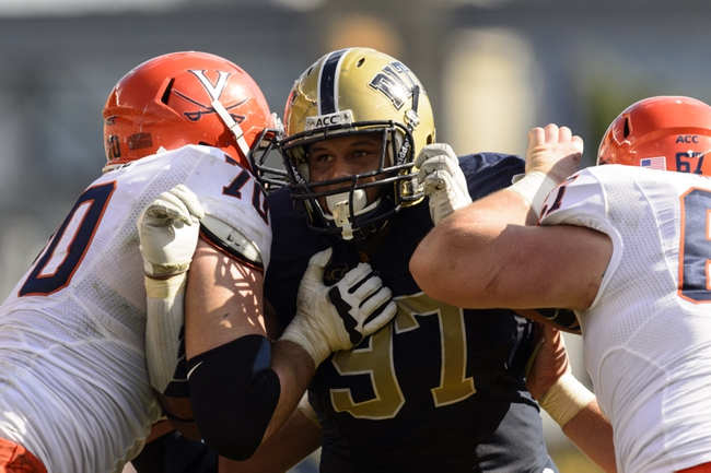 Sep 28, 2013; Pittsburgh, PA, USA; Pittsburgh Panthers defensive lineman Aaron Donald (97) is blocked by Virginia Cavaliers offensive guard Luke Bowanko (70) and center Jackson Matteo (67) during the fourth quarter at Heinz Field. Pittsburgh defeated Virginia 14-3. Mandatory Credit: Howard Smith-USA TODAY Sports