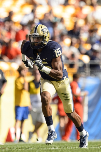 Sep 28, 2013; Pittsburgh, PA, USA; Pittsburgh Panthers wide receiver Devin Street (15) during the fourth quarter against the Virginia Cavaliers at Heinz Field. Pittsburgh defeated Virginia 14-3. Mandatory Credit: Howard Smith-USA TODAY Sports