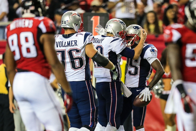 Sep 29, 2013; Atlanta, GA, USA; New England Patriots wide receiver Kenbrell Thompkins (85) celebrates a touchdown with quarterback Tom Brady (12) in the second half at the Georgia Dome. The Patriots won 30-23. Mandatory Credit: Daniel Shirey-USA TODAY Sports