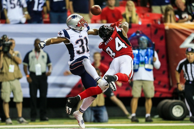 Sep 29, 2013; Atlanta, GA, USA; New England Patriots cornerback Aqib Talib (31) breaks up a pass in the end zone intended for Atlanta Falcons wide receiver Roddy White (84) in the final seconds in the fourth quarter at the Georgia Dome. The Patriots won 30-23. Mandatory Credit: Daniel Shirey-USA TODAY Sports