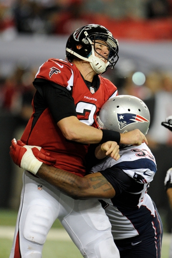 Sep 29, 2013; Atlanta, GA, USA; New England Patriots defensive lineman Tommy Kelly (93) hits Atlanta Falcons quarterback Matt Ryan (2) during the second half at Georgia Dome. The Patriots defeated the Falcons 30-23. Mandatory Credit: Dale Zanine-USA TODAY Sports