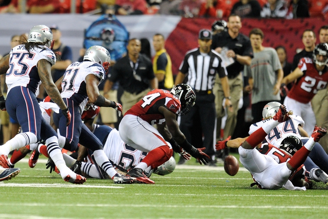 Sep 29, 2013; Atlanta, GA, USA; Atlanta Falcons linebacker Stephen Nicholas (54) recovers an onside kick against the New England Patriots during the second half at Georgia Dome. The Patriots defeated the Falcons 30-23. Mandatory Credit: Dale Zanine-USA TODAY Sports